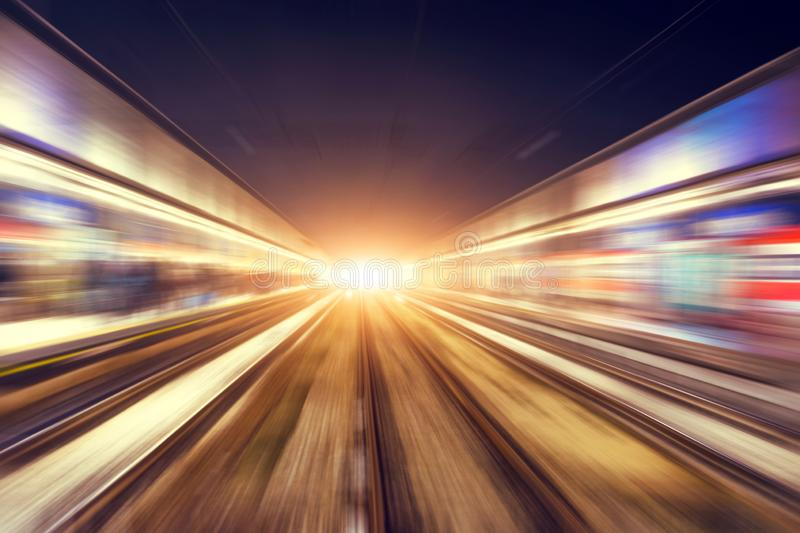Motion blur movement through the city at night by train.  stock image