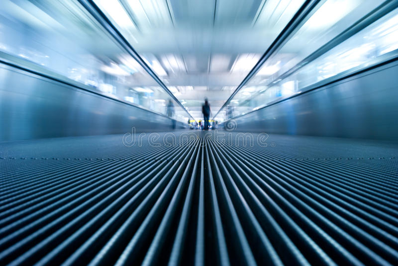 Motion blur of moving escalator in airport stock images