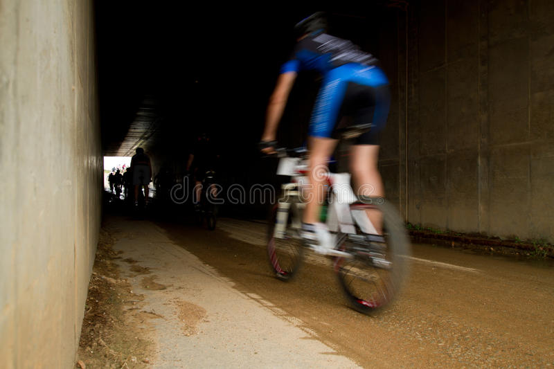 Download Motion Blur Of MTB Rider Entering Tunnel Editorial Image - Image: 18878225