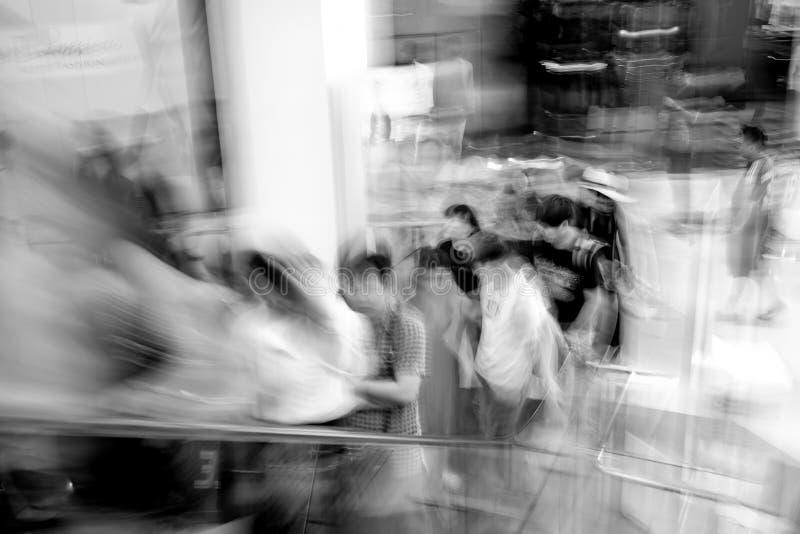 Motion blur people on escalator royalty free stock photos