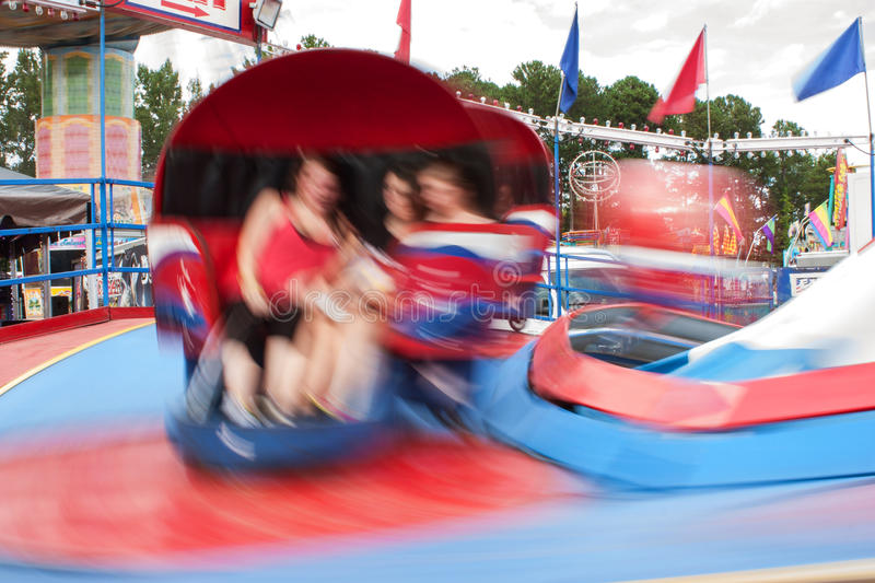Motion Blur Of People On Fast Moving Carnival Ride royalty free stock photography