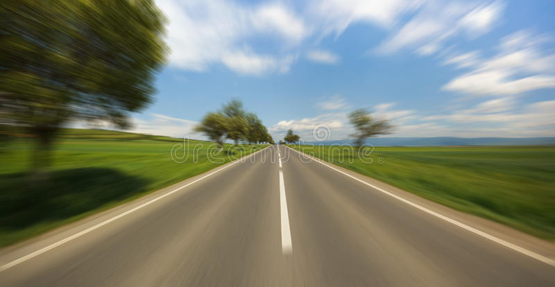 Motion blur road. Seen from fast moving car royalty free stock photos