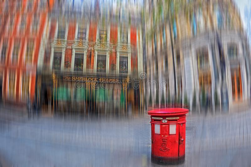 Motion blur with Sherlock Holmes Pub and typical old red british stock photos
