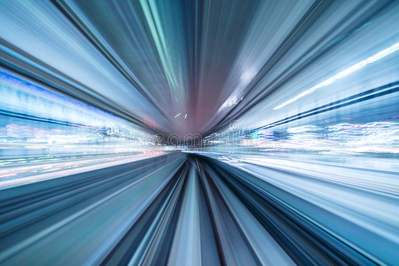 Motion blur of train moving inside tunnel with daylight in tokyo, Japan royalty free stock photography