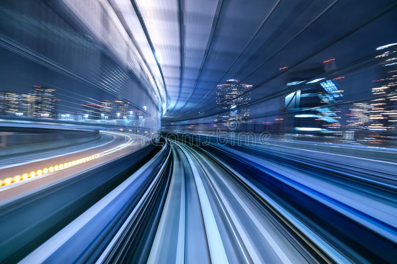 Motion blur of train moving inside tunnel, Japan stock photography