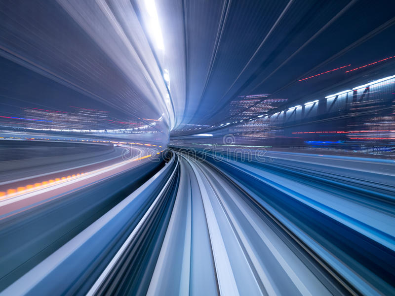 Motion blur of train moving inside tunnel, Japan royalty free stock photography