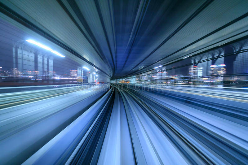 Motion blur of train moving inside tunnel in Tokyo, Japan royalty free stock photography