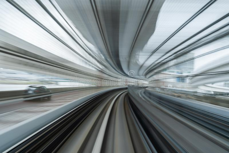 Motion blur of train running on tunnel in Tokyo, Japan stock image
