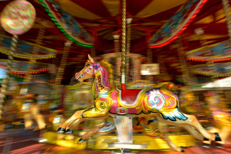 Motion blurr of vintage horse of amusement ride on merry-go-round carousel. Amusement concept royalty free stock photography
