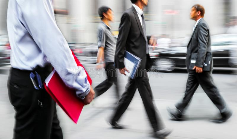 Business people at rush hour walking in the street, in the style stock images