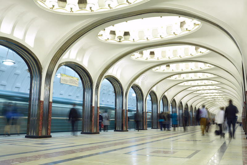 Motion blurred commuters at the metro station. Mayakovskaya station in Moscow underground. Beautiful arch architecture royalty free stock photos