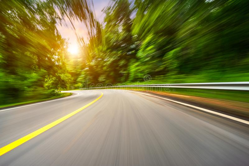 Motion blurred highway. In mountain stock photo