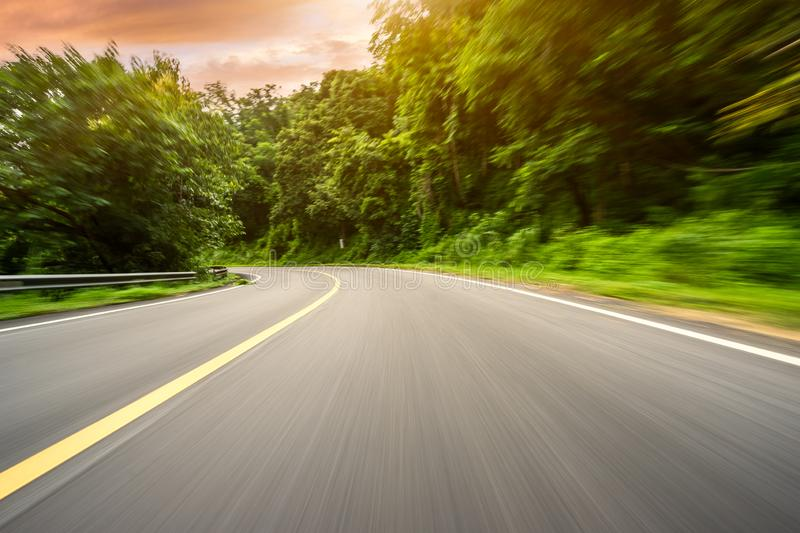 Motion blurred highway. In mountain stock photography