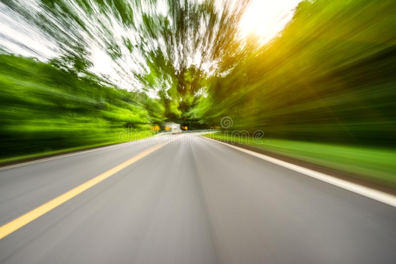Motion blurred highway. In mountain stock photos