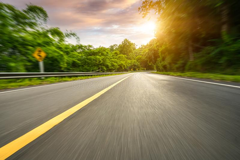 Motion blurred highway. In mountain stock images