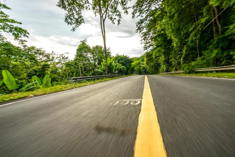 Motion blurred highway. In mountain stock image