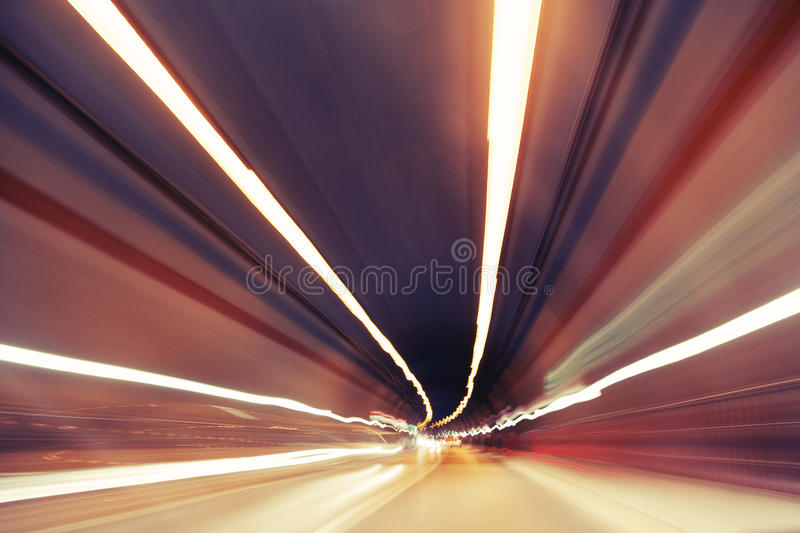 Motion blurred modern traffic tunnel stock photography