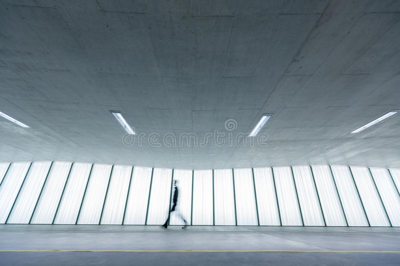 Motion blurred people  in an underpassage stock images