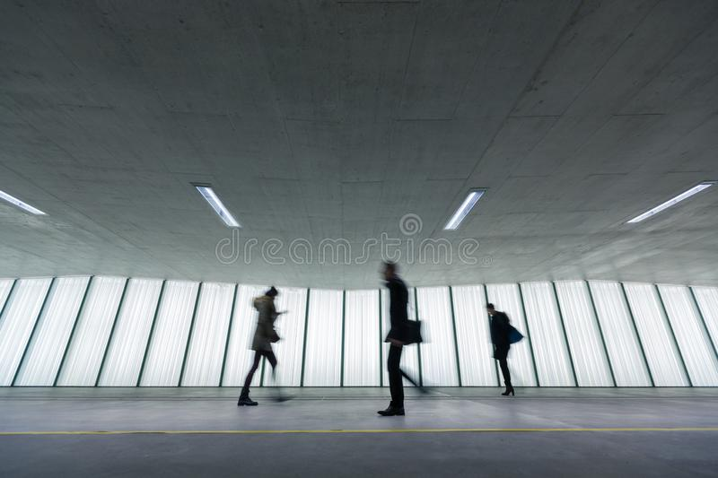 Motion blurred people  in an underpassage royalty free stock photo