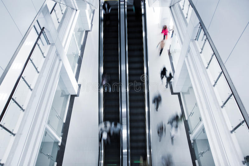 Motion blurred people on stairs stock photography