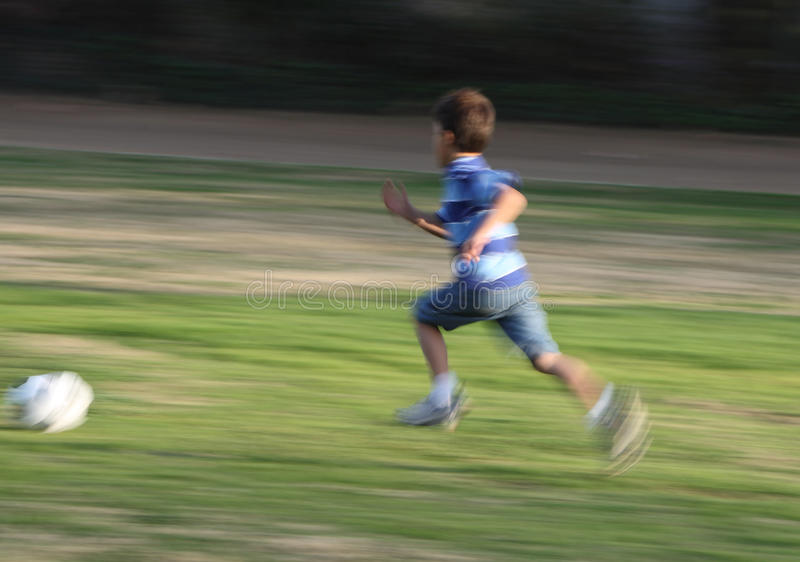 Download Motion Blurred Photo Of Boy Running Stock Photo - Image of athletic, smiling: 18075178