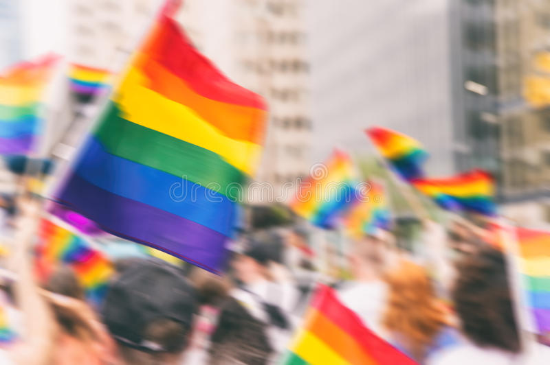 Motion blurred picture of gay rainbow flags. During pride parade. Concept of LGBT rights stock image