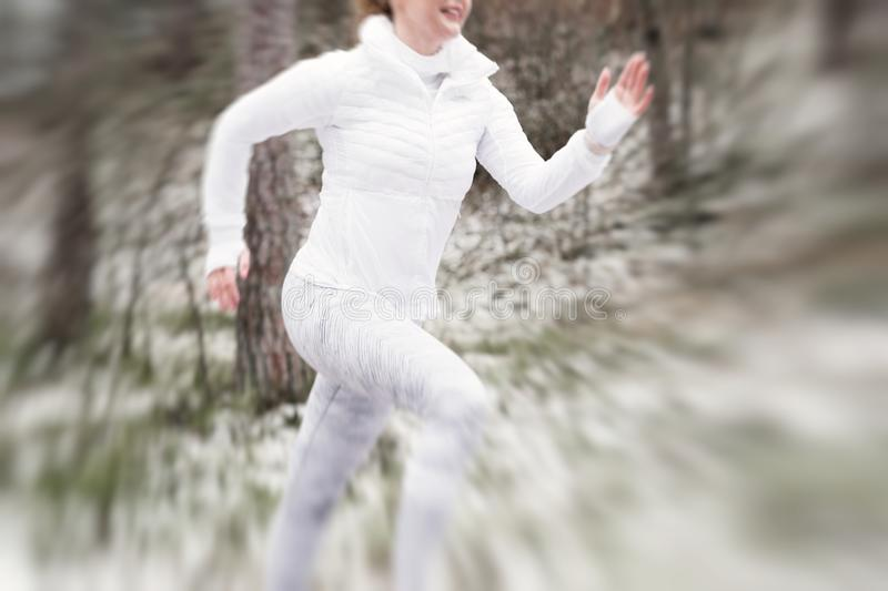 Motion blurred runner in winter royalty free stock photography