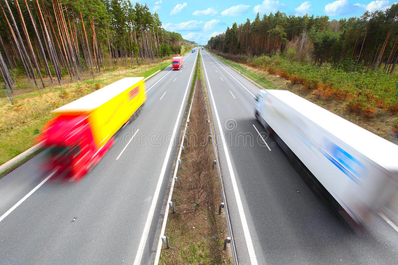 Download Motion Blurred Trucks On Highway. Royalty Free Stock Photography - Image: 19149457