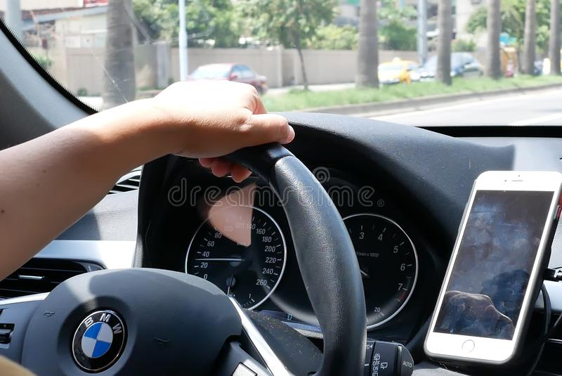 Motion of car driving on road and focusing on car dashboard royalty free stock photos