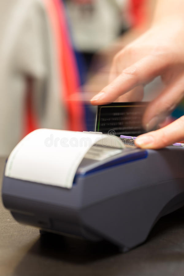 Motion of Hand With Credit Card Swipe Through Terminal For Sale stock photos