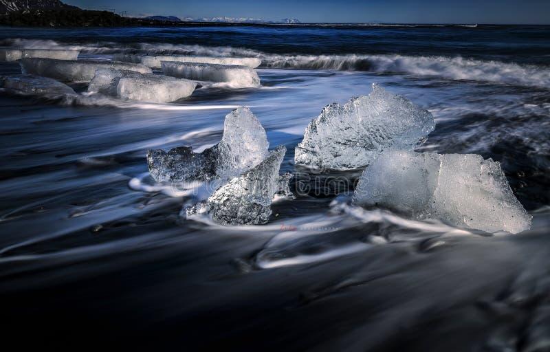 Motion movement iceberg at beach at Jokursarlon, Iceland with slow shutter technic stock image