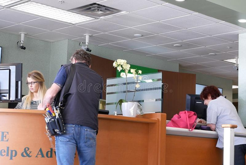 Motion of people talking to the teller at service counter inside TD bank royalty free stock photos