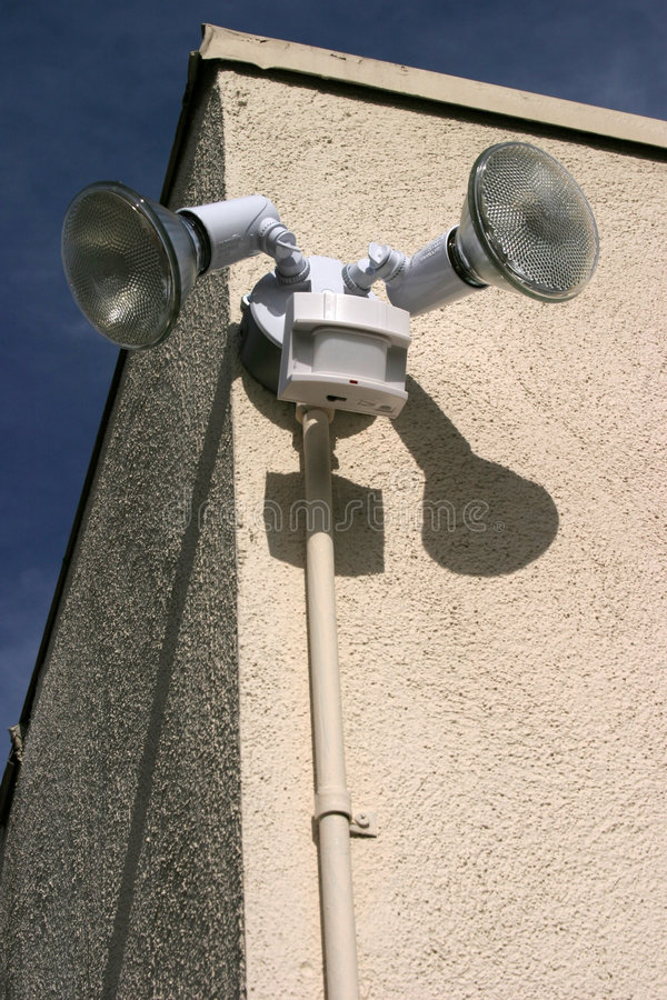 Motion sensor lights on the side of a building royalty free stock photography