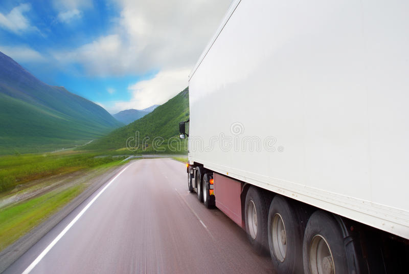Motion of white semi-truck stock images