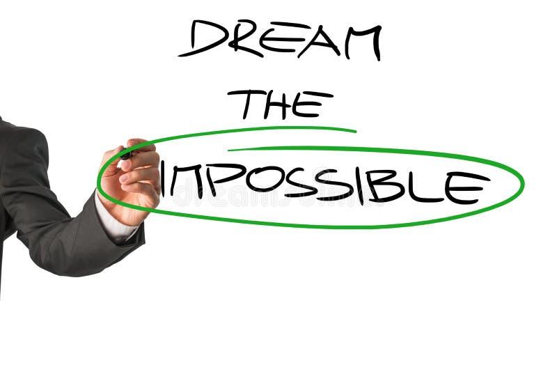Motivador personal que escribe a un sueño el mensaje imposible foto de archivo libre de regalías