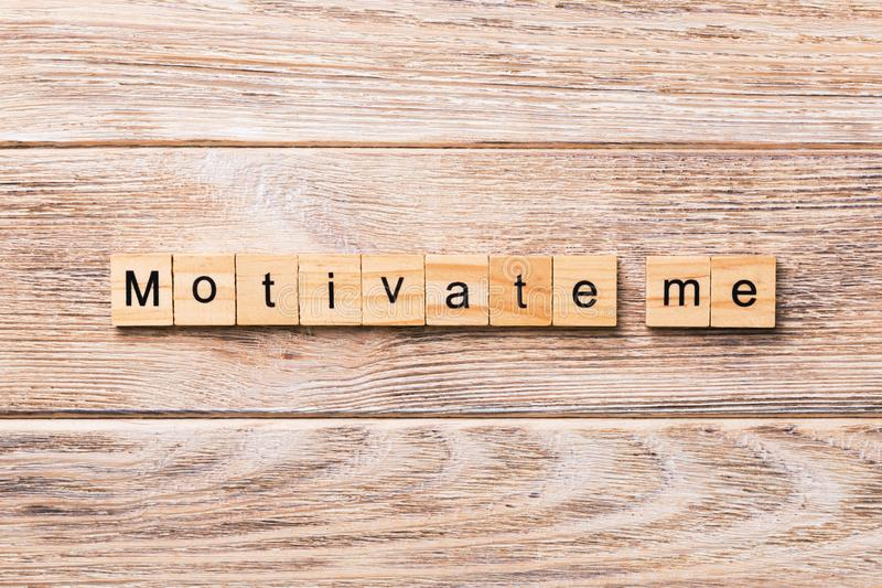 Motivate me word written on wood block. Motivate me text on wooden table for your desing, concept.  stock photography