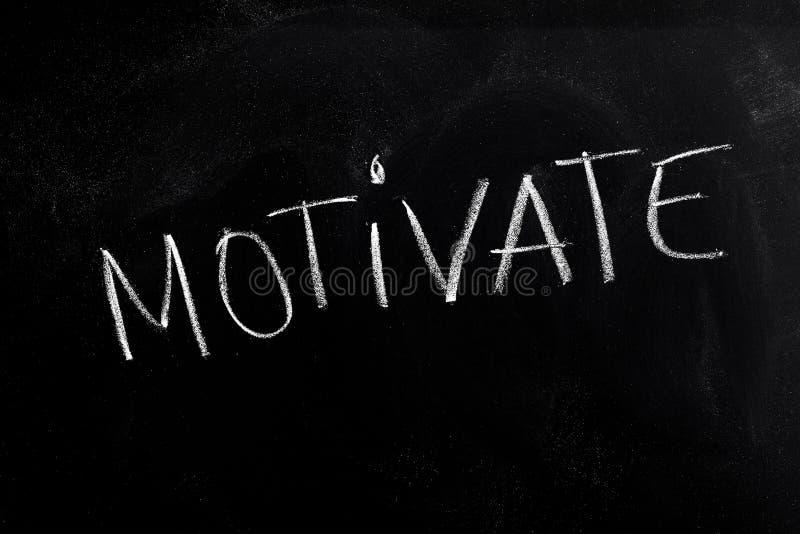 Motivate Text on Blackboard stock photos