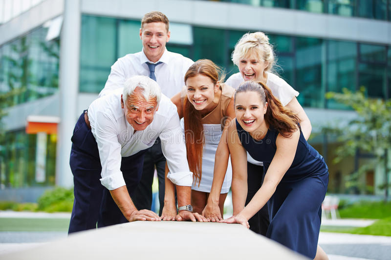 Motivated business team working together royalty free stock photo