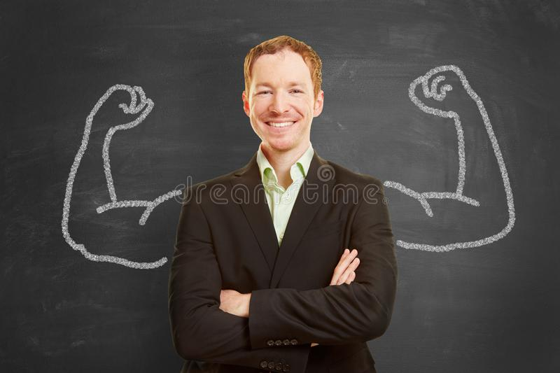 Businessman with painted muscles royalty free stock photography