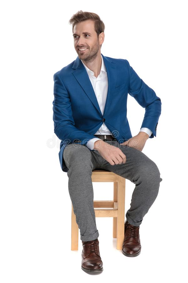 Motivated casual men looking to the side hopeful royalty free stock photography