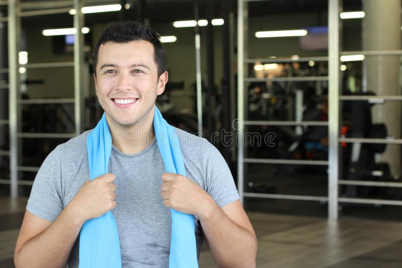 Motivated ethnic man at the gym stock photo