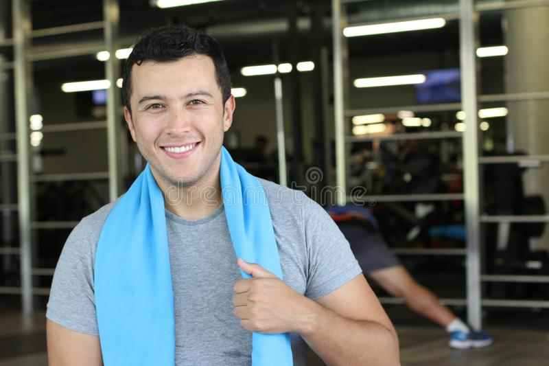 Motivated ethnic man at the gym stock photos