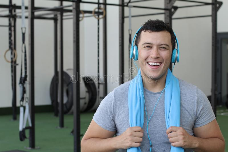 Motivated ethnic man at the gym stock images