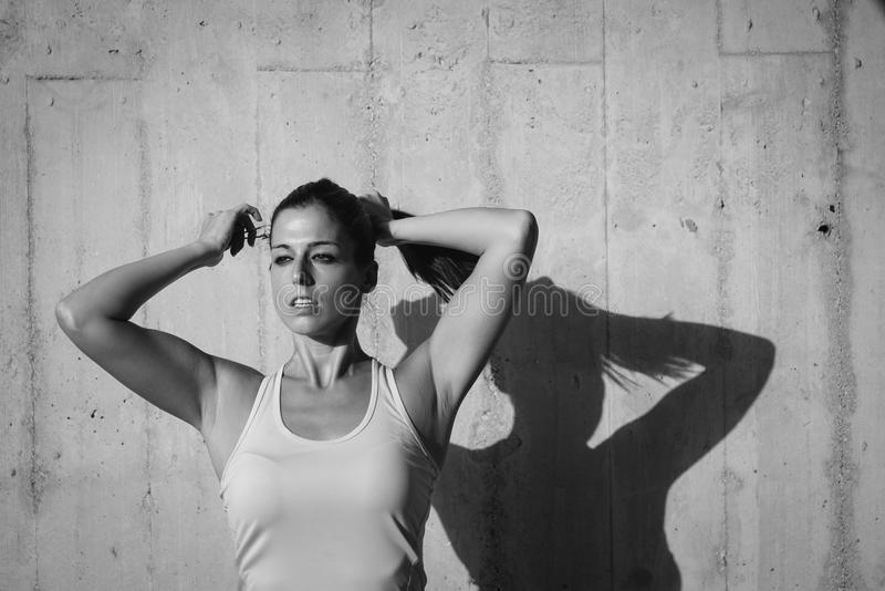 Sportswoman getting ready for working out royalty free stock photo