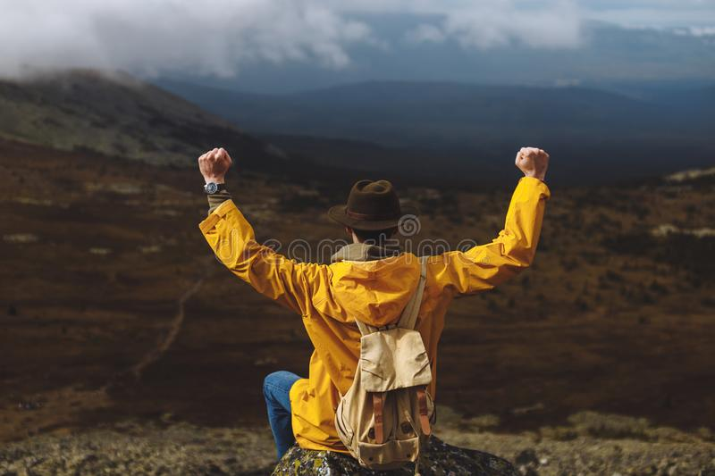 Motivated hiker with raised clenched fists is rejoicing at his climbing royalty free stock images