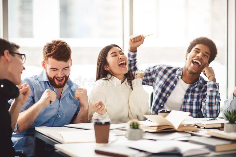 Motivated students celebrating finished learning for test royalty free stock photo