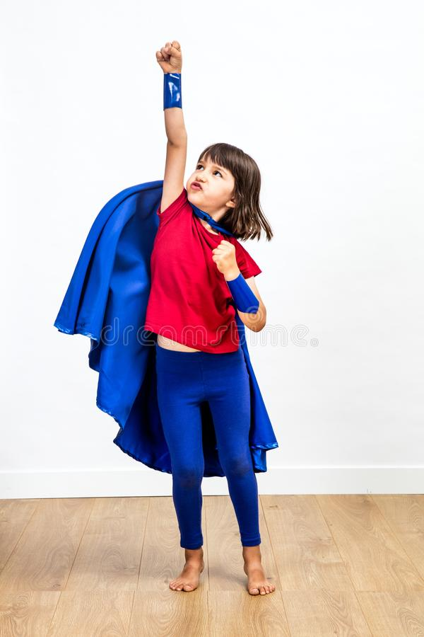 Free Motivated Super Hero Kid Showing Strength And Imagination, Reaching Success Stock Images - 99370324