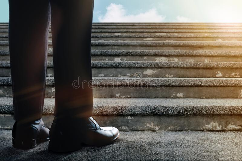 Motivation and Challenging in Career. Successful Concept. Low Section of Businessman Standup on Staircase. Get Ready to Moving stock photo