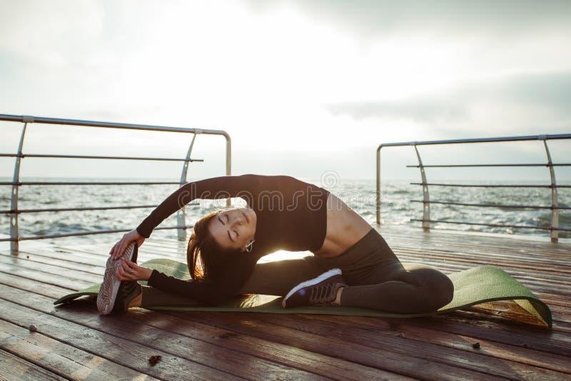Motivation i sportar fotografering för bildbyråer