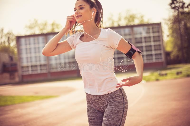 Motivation music need you for good exercise. Sports person royalty free stock photos